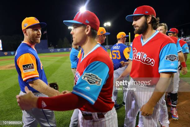 Todd Frazier of the New York Mets shakes hands with Scott Kingery of the Philadelphia Phillies after the 2018 Little League Classic at Historic...