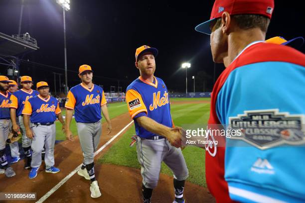 Todd Frazier of the New York Mets shakes hands with the Philadelphia Phillies after the 2018 Little League Classic at Historic Bowman Field on Sunday...
