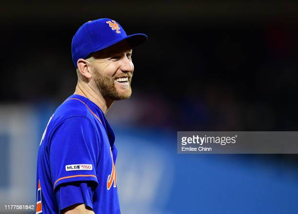Todd Frazier of the New York Mets smiles in the seventh inning of their game against the Atlanta Braves at Citi Field on September 27 2019 in the...