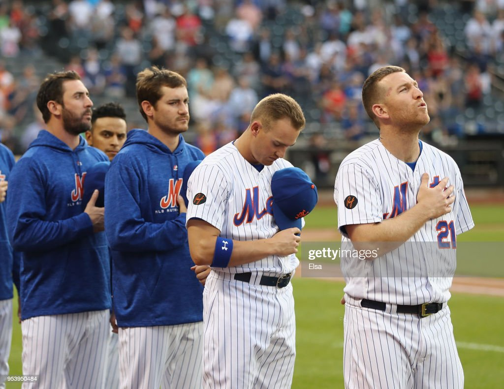 Todd Frazier #21 of the New York Mets stands with his teammates as the national anthem is played before the game against the Atlanta Braves on May 2, 2018 at Citi Field in the Flushing neighborhood of the Queens borough of New York City.