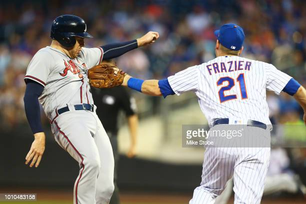 Todd Frazier of the New York Mets tags out Freddie Freeman of the Atlanta Braves on a fielders choice in the fourth inning at Citi Field on August 3...
