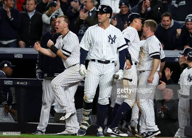 Todd Frazier of the New York Yankees celebrates after a go ahead run during the eighth inning against the Houston Astros in Game Four of the American...