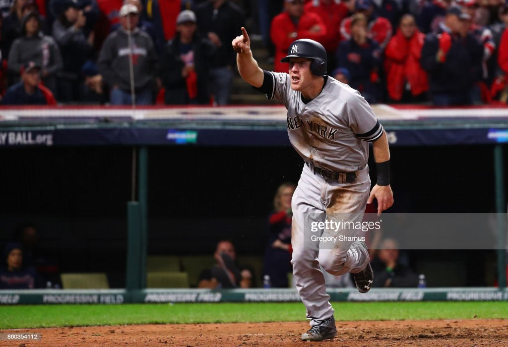 Todd Frazier #29 of the New York Yankees celebrates after scoring on a single by Brett Gardner #11 in the ninth inning against the Cleveland Indians in Game Five of the American League Divisional Series at Progressive Field on October 11, 2017 in Cleveland, Ohio.