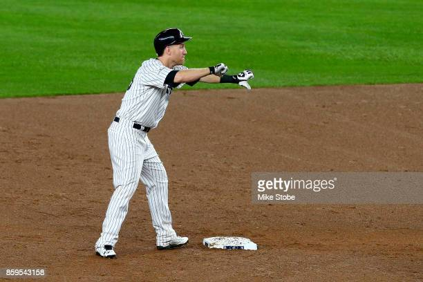Todd Frazier of the New York Yankees celebrates from second base after he hit a double to left field to score Starlin Castro against Trevor Bauer of...