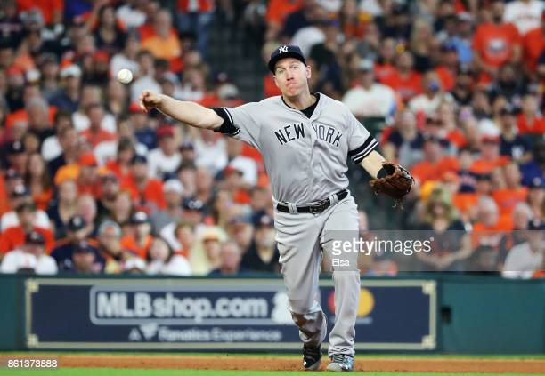 Todd Frazier of the New York Yankees fields a groundball by George Springer of the Houston Astros for an out in the sixth inning during game two of...