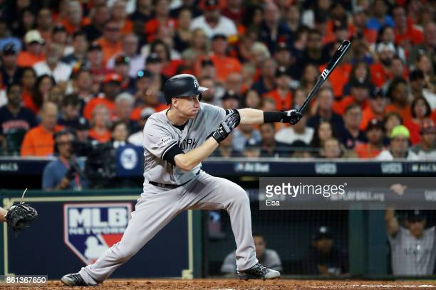 Todd Frazier of the New York Yankees hits a groundrule double scoring Aaron Hicks in the fifth inning against the Houston Astros during game two of...