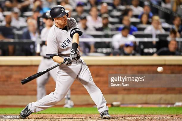 Todd Frazier of the New York Yankees hits a three run home run during the fourth inning against the Tampa Bay Rays at Citi Field on September 11 2017...