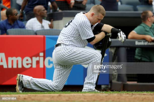 Todd Frazier of the New York Yankees reacts after a child was hit by a foul ball off his bat in the fifth inning against the Minnesota Twins on...