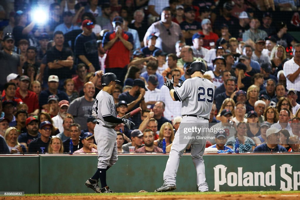 Todd Frazier #29 of the New York Yankees reacts after hitting a solo home run in the sixth inning of a game aggainst the Boston Red Sox at Fenway Park on August 19, 2017 in Boston, Massachusetts.