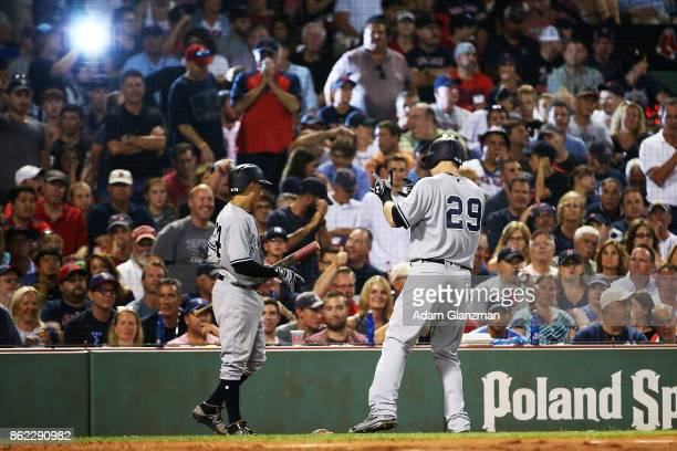 Todd Frazier of the New York Yankees reacts after hitting a solo home run in the sixth inning of a game aggainst the Boston Red Sox at Fenway Park on...