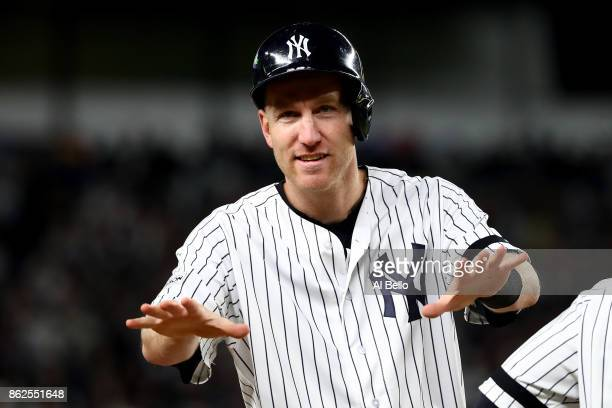 Todd Frazier of the New York Yankees reacts on third base after a double by Chase Headley during the eighth inning against the Houston Astros in Game...