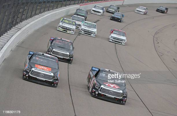 Todd Gilliland driver of the JBL/SiriusXM Toyota and Harrison Burton driver of the Morton Buildings Toyota lead a pack of trucks during the NASCAR...
