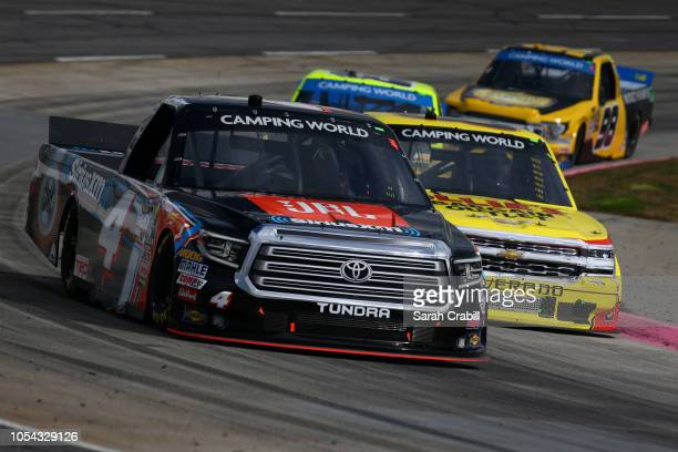 Todd Gilliland driver of the JBL/SiriusXM Toyota leads a pack of trucks during the NASCAR Camping World Truck Series Texas Roadhouse 200 presented by...