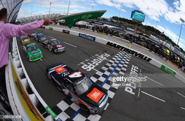 Todd Gilliland driver of the JBL/SiriusXM Toyota leads the field to the green flag to start the NASCAR Camping World Truck Series Texas Roadhouse 200...