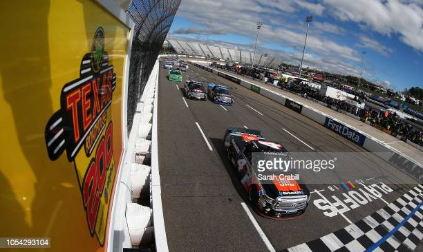 Todd Gilliland driver of the JBL/SiriusXM Toyota leads the field under caution prior to the NASCAR Camping World Truck Series Texas Roadhouse 200...