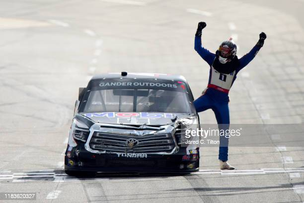 Todd Gilliland driver of the Mobil 1 Toyota celebrates winning the NASCAR Gander Outdoor Truck Series NASCAR Hall of Fame 200 at Martinsville...
