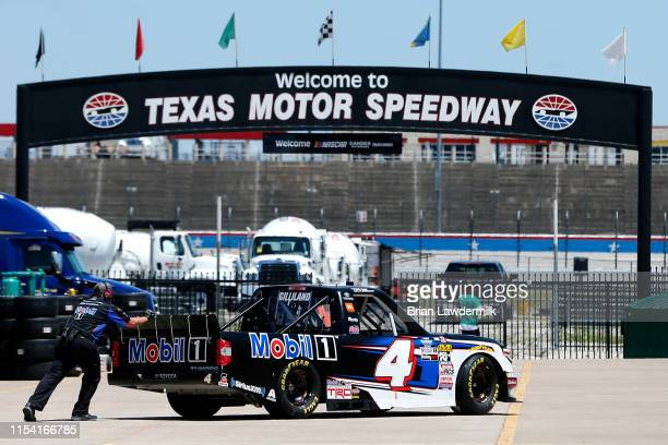 Todd Gilliland driver of the Mobil 1 Toyota drives through the garage during practice for the NASCAR Gander Outdoors Truck Series SpeedyCashcom 400...