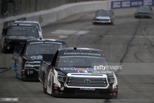 Todd Gilliland driver of the Mobil 1 Toyota leads a pack of cars during the NASCAR Gander Outdoors Truck Series Ultimate Tailgating 200 at Atlanta...