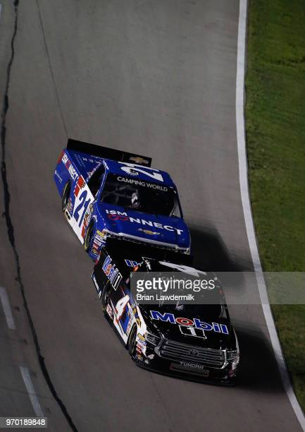 Todd Gilliland driver of the Mobil 1 Toyota races Johnny Sauter driver of the ISM Connect Chevrolet during the NASCAR Camping World Truck Series PPG...