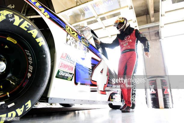 Todd Gilliland driver of the Mobil 1 Toyota stands in the garage area during practice for the NASCAR Camping World Truck Series PPG 400 at Texas...