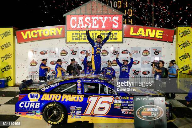 Todd Gilliland driver of the NAPA Auto Parts Toyota celebrates in Victory Lane after winning the NASCAR KN Pro Series East Casey's General Store 150...