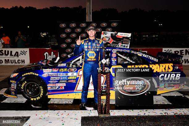 Todd Gilliland driver of the NAPA Auto Parts Toyota celebrates in victory lane after winning the NASCAR KN Pro Series East Visit Hampton Virginia 150...
