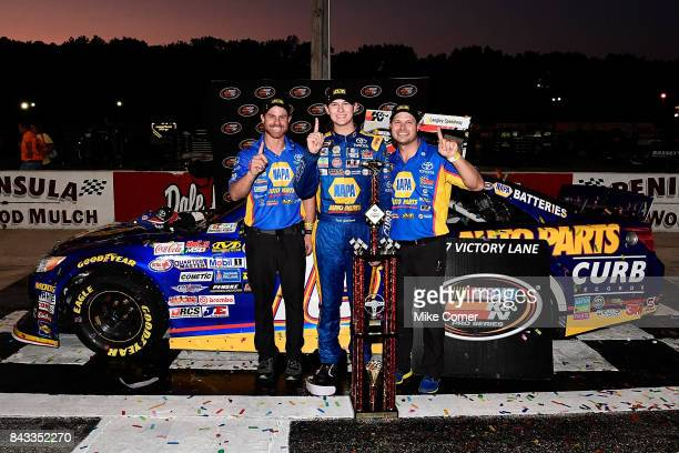 Todd Gilliland driver of the NAPA Auto Parts Toyota celebrates with his team in victory lane after winning the NASCAR KN Pro Series East Visit...