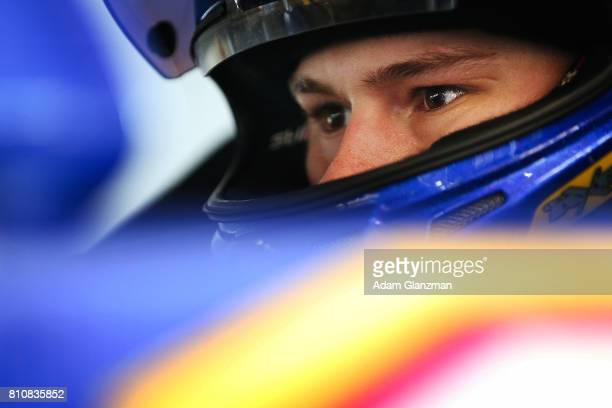 Todd Gilliland driver of the NAPA Auto Parts Toyota looks on from his car in the garage during practice before the NASCAR KN Pro Series East at...