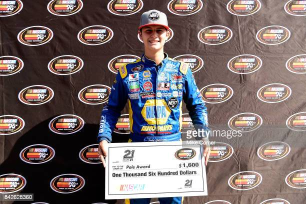 Todd Gilliland driver of the NAPA Auto Parts Toyota poses with a check for winning the pole award for the NASCAR KN Pro Series East Visit Hampton...