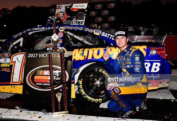 Todd Gilliland driver of the NAPA Auto Parts Toyota poses with the winner's trophy in victory lane after winning the NASCAR KN Pro Series East Visit...