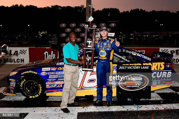 Todd Gilliland driver of the NAPA Auto Parts Toyota receives the winner's trophy in victory lane after winning the NASCAR KN Pro Series East Visit...