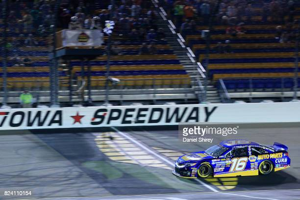 Todd Gilliland driver of the NAPA Auto Parts Toyota takes the checkered flag to win the NASCAR KN Pro Series East Casey's General Store 150 at Iowa...