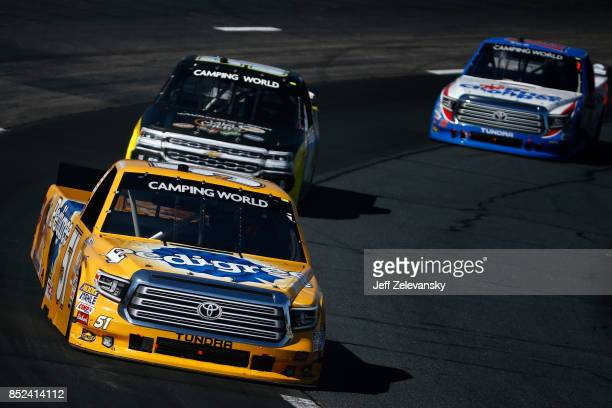 Todd Gilliland driver of the Pedigree Toyota leads a pack of trucks during the NASCAR Camping World Truck Series UNOH 175 at New Hampshire Motor...