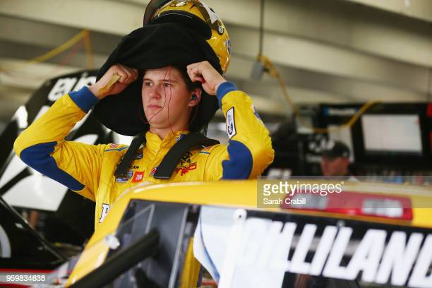 Todd Gilliland driver of the Pedigree Toyota stands in the garage during practice for the NASCAR Camping World Truck Series North Carolina Education...