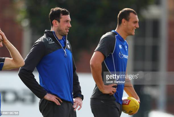 Todd Goldstein and Braydon Preuss of the Kangaroos look on during a North Melbourne Kangaroos AFL training session at Arden Street Ground on June 15...