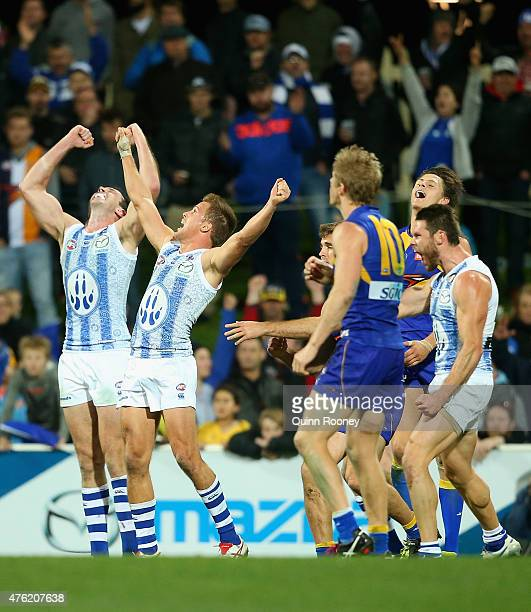 Todd Goldstein Andrew Swallow and Sam Gibson of the Kangaroos celebrate winning the round 10 AFL match between the North Melbourne Kangaroos and the...