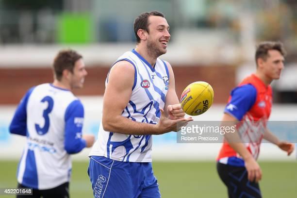 Todd Goldstein handballs during a North Melbourne Kangaroos AFL media session at Arden Street Ground on July 16 2014 in Melbourne Australia