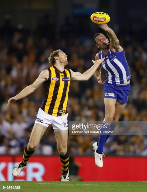 Todd Goldstein of the Kangaroos and Ben McEvoy of the Hawks compete in a ruck contest during the 2018 AFL round five match between the North...