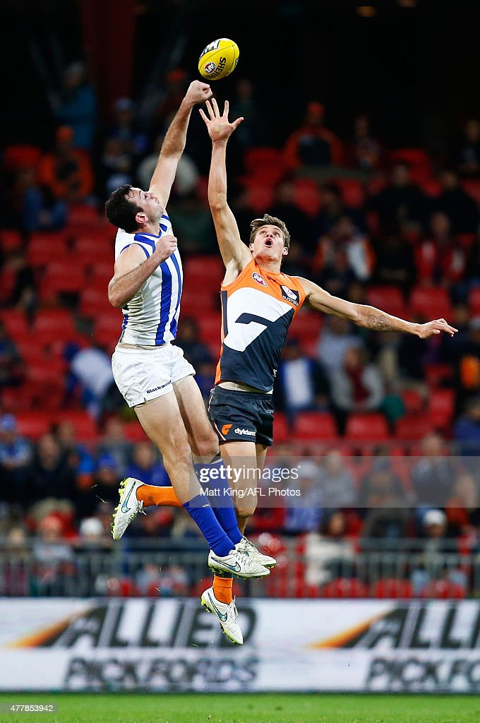 Todd Goldstein of the Kangaroos and Rory Lobb of the Giants compete for the ball during the round 12 AFL match between the Greater Western Sydney Giants and the North Melbourne Kangaroos at Spotless Stadium on June 20, 2015 in Sydney, Australia.