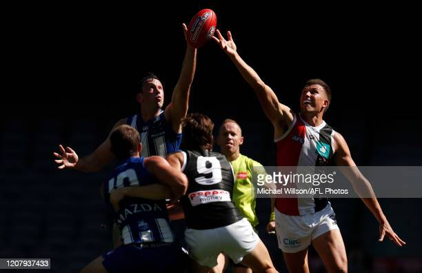 Todd Goldstein of the Kangaroos and Rowan Marshall of the Saints compete in a ruck contest during the 2020 AFL Round 01 match between the North...