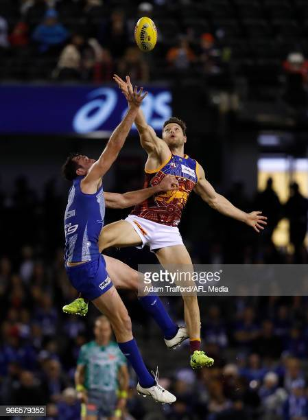 Todd Goldstein of the Kangaroos and Stefan Martin of the Lions compete in a ruck contest during the 2018 AFL round 11 match between the North...