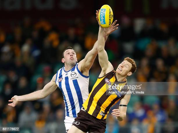 Todd Goldstein of the Kangaroos and Tim O'Brien of the Hawks compete in a ruck contest during the 2017 AFL round 21 match between the Hawthorn Hawks...