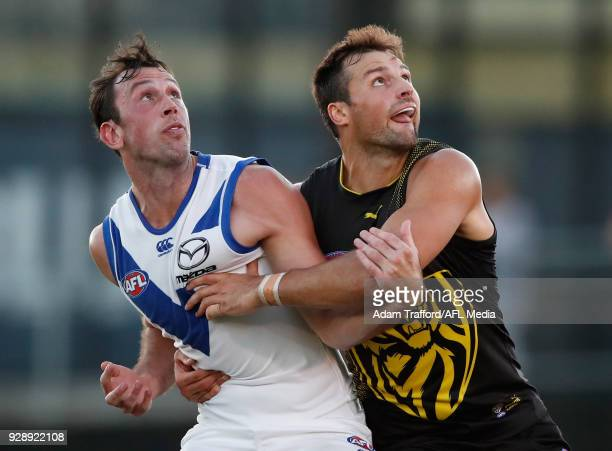 Todd Goldstein of the Kangaroos and Toby Nankervis of the Tigers compete in a ruck contest during the AFL 2018 JLT Community Series match between the...