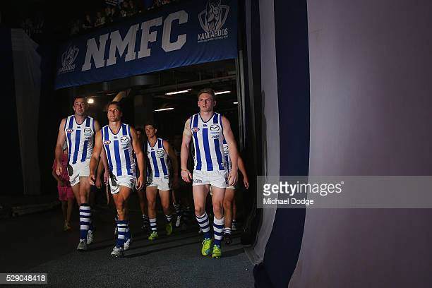 Todd Goldstein of the Kangaroos Andrew Swallow and Jack Ziebell leads the team out after half time during the round seven AFL match between the St...