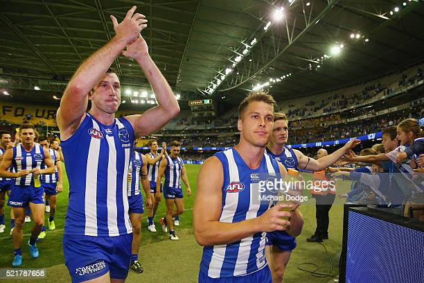 Todd Goldstein of the Kangaroos Andrew Swallow and Jack Ziebell of the Kangaroos celebrate the win during the Round 4 AFL match between North...