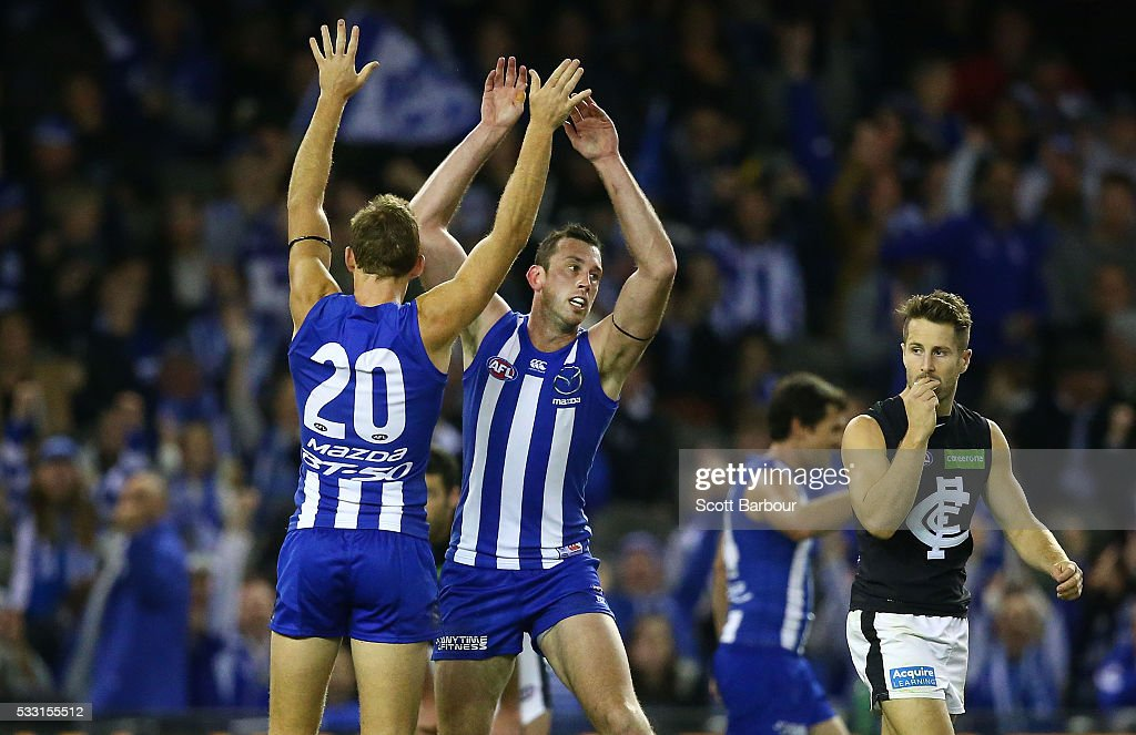 Todd Goldstein of the Kangaroos celebrates after kicking a goal with Drew Petrie of the Kangaroos during the round nine AFL match between the North Melbourne Kangaroos and the Carlton Blues at Etihad Stadium on May 21, 2016 in Melbourne, Australia.