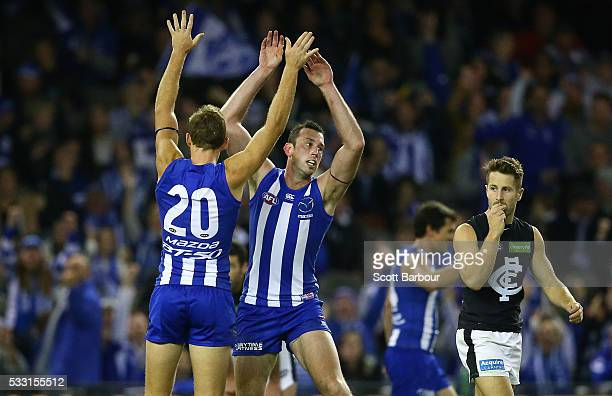 Todd Goldstein of the Kangaroos celebrates after kicking a goal with Drew Petrie of the Kangaroos during the round nine AFL match between the North...