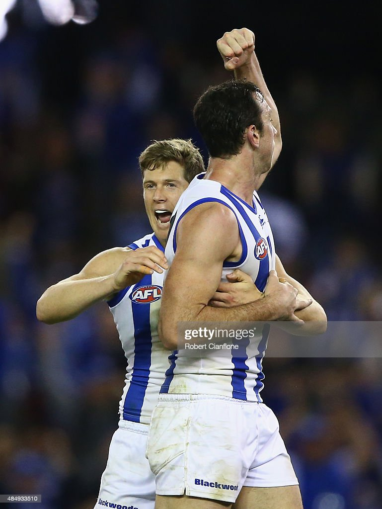Todd Goldstein of the Kangaroos celebrates with Nick Del Santo after scoring a goal during the round 21 AFL match between the North Melbourne Kangaroos and the Fremantle Dockers at Etihad Stadium on August 23, 2015 in Melbourne, Australia.