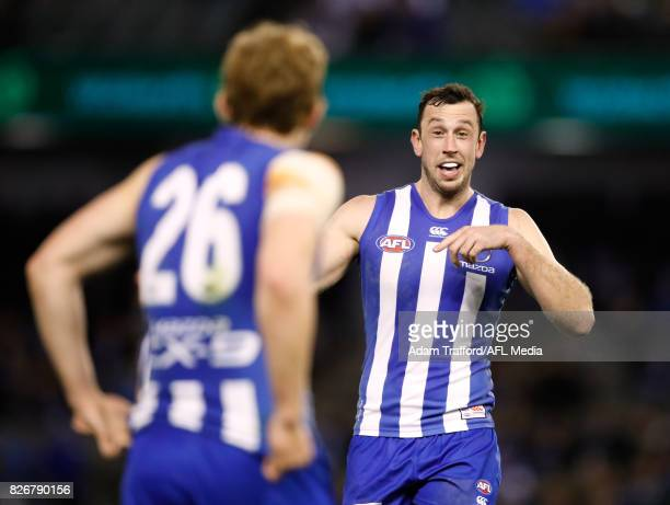 Todd Goldstein of the Kangaroos chats to Daniel Nielson of the Kangaroos during the 2017 AFL round 20 match between the North Melbourne Kangaroos and...