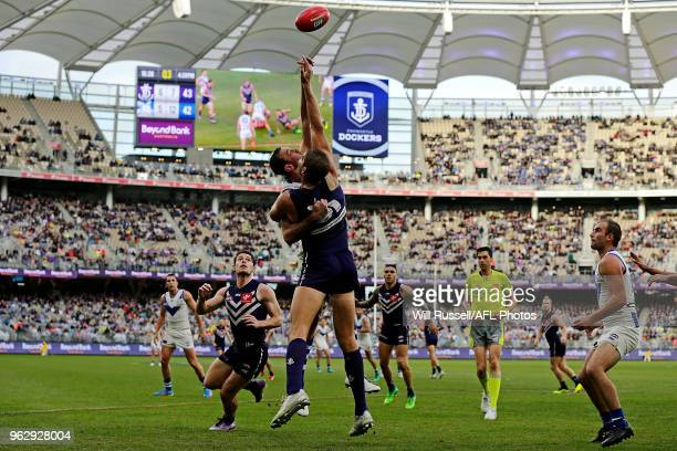 Todd Goldstein of the Kangaroos contests a ruck with Aaron Sandilands of the Dockers during the round 10 AFL match between the Fremantle Dockers and...
